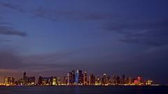 Doha Cityscape (Sanjiban2011) Tags: city longexposure nightphotography sky panorama skyline clouds lights evening nikon cityscape waterfront outdoor wideangle bluesky corniche citylights d750 bluehour fullframe fx tamron doha qatar westbay dohawestbay tamron1530