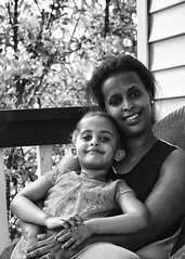 Neighbors and Friends (Portraitsteve) Tags: girls blackandwhite bw hands daughter mother smiles females ethiopian