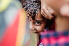 Peeping out | Vrindavan,India (vjisin) Tags: travel portrait people blackandwhite india girl smile field 50mm kid eyes nikon asia child peep depth nifty mathura nikond3200 portraitphotography indiangirl chennaiweekendclickers nikonofficial cwc497