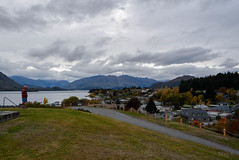 View over to the Mountians (Jocey K) Tags: road autumn trees houses newzealand sky people architecture clouds town view hills autumncolours southisland centralotago wanaka mountians lakewanaka tripdownsouth wanakavillage