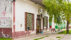 Bicycle parked at the shop. (mathematikaren) Tags: village serbia balkans easterneurope vojvodina donauschwaben ravnoselo schowe vojvodenia