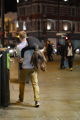 Human Scarf (Magic Pea) Tags: street woman man london night hair photography photo funny camden candid streetphotography camdentown quirky carry magicpea