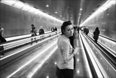 girl in long tunnel with nice lights (gorbot.) Tags: barcelona blackandwhite bw underground subway tube rangefinder f4 roberta leicam8 ltmmount voigtlander21mmcolorskoparf4