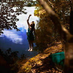 how delicate life is. (Casey David) Tags: blue woman sun lake tree water girl yellow lady standing forest reflections boat moss woods dress reaching turquoise branches bank ground canoe ripples reach delicate fragile flowersinhair caseydavid caseydavidphotography