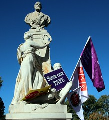 Education union flags and placards on monument