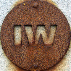 IW (chrisinplymouth) Tags: uk england sculpture art sign metal cutout circle rust iron unitedkingdom steel letters rusty plymouth plate devon round oxidation squaredcircle rusting squircle alphabet disc corrosion mountbatten corroded doublet iw twoletter cw69x chrisinplymouth nauticaltelegraphcode