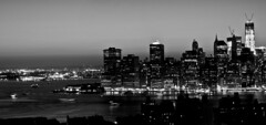 New York City at night: Black and White Panorama (superbowl2265) Tags: newyorkcity longexposure blackandwhite bw water brooklyn night buildings reflections lights manhattan freedomtower boatlights boattrails worldtradecenterone