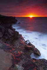 Cape Solander Sunrise - V2 (stevoarnold) Tags: sunset red sea clouds sunrise rocks sydney australia cliffs burning nsw capesolander