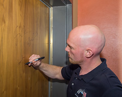 Signing the door (Astro_Alex) Tags: media review briefing
