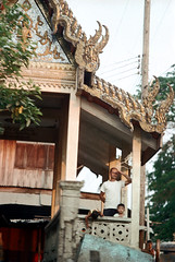 19-240 (ndpa / s. lundeen, archivist) Tags: roof boy people man color building film rooftop water architecture kids 35mm children thailand temple canal shrine child bangkok buddhist nick decoration canals thai watersedge 1970s ornate gilded 1972 19 1973 klong finial dewolf finials guilding khlong klongs nickdewolf photographbynickdewolf khlongs reel19