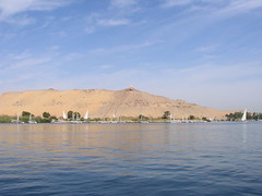 Aswan, view of Qubbet el-Hawa from the Nile (dr.heatherleemccarthy) Tags: morning monument water cemetery landscape egypt nile sailboats hillside aswan tombs necropolis