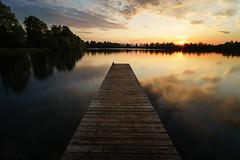 Sunset Mirror (xxremixx) Tags: longexposure sunset sun lake reflection clouds germany bayern deutschland bavaria mirror golden see pier sonnenuntergang sundown sony wolken frstenfeldbruck hour sonne plank ultra spiegelung a7 steg weitwinkel ndfilter ultrawideangle olchinger nd3 nd1000 goldenestunde