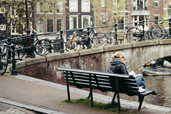 Reading (t-a-i) Tags: street woman netherlands girl amsterdam bicycle bench 50mm reading sony voigtlander streetphotography nl voigtlnder 50mmf14 50mmf15 voigtlandernokton50mmf15 voigtlander50mmf15 voigtlnder50mmf15 sonya7rii a7rii a7rmkii a7r2 sonyilce7rm2 sony7rii ilce7rm2 7rii