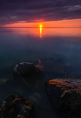 Chippewa Sunrise (Cale Best Photography) Tags: morning light sun lake ontario canada color colour beach nature water clouds sunrise landscape dawn rocks peace horizon calming peaceful calm shore windsor burst lakestclair tecumseh