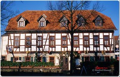 Landgasthof Anker  (M.A.K.photo) Tags: leica city building film analog germany deutschland hessen kodak outdoor slide slidefilm summicron stadt architektur ektachrome bauwerk halftimbered archtecture gasthaus hanau fachwerk kodakfilm diapositiv analogphoto philippsruhe gasthof ektachromee100vs fachwerkbau analogfoto hanauammain summicron2035mm leitzleica landgasthofanker photospourtousphotosforal