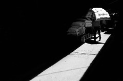 Light and Dark (Saman A. Ali) Tags: street light people blackandwhite man black monochrome shop blackbackground work dark photography blackwhite market outdoor background streetphotography documentary fujifilm 16mm fujinon stphotografia fujifilmxt1