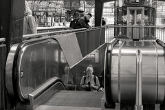 That sly glance (Mr.White@66) Tags: station amsterdam candid escalator streetphotography