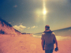 Lobster Beach (The Nick Page) Tags: red sun beach portugal toycamera fisheye 110film redscale superheadz