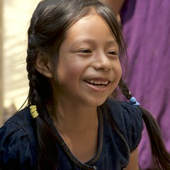 a sparkling Guatemalan face (Pejasar) Tags: girl child student antigua guatemala escuelaintegrada pigtails smile