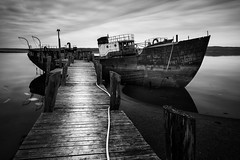 Old Scow (Nate Parker Photography) Tags: longexposure winter blackandwhite bw monochrome coast pier dock ship maine newengland coastline interview mainecoast haveaniceday dockside oldscow rustyship rustyhulk photographyoffice rustyscow