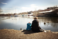 Sunday, Out and About (Fredrik Forsberg) Tags: snow spring melting sitting sweden stockholm daughter mother vr hgersten hgerstenshamnen wateredge panasoniclumixg14mmf25asph panasonicgx1