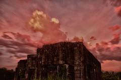 The Ruin   Suburb (Mari Concepcon) Tags: sky nature colors silhouette clouds photoshop landscape photography haze nikon ruins dusk philippines kitlens manila nik 1855mm cloudscape 1855mmkitlens postprocessing photomatix nd8 viveza silhouettephotography d3100 nikond3100 vivezaphotoshop itsmorefuninthephilippines sunsetgoddess suburbruins queenofsunsets