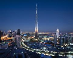 Beautiful Dubai #4 (momentaryawe.com) Tags: city urban glass reflections concrete lights evening dubai cityscape skyscrapers dusk uae middleeast bluehour unitedarabemirates businessbay d300s catalinmarin momentaryawecom burjkhalifa