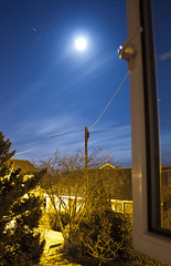 Outside The Window (Spencer Purkiss) Tags: blue light moon color colour window lines yellow night stars outside outdoors gold star golden wire colorful glow outdoor telephone line pole pylon fullmoon wires moonlight glowing colourful outsidethewindow