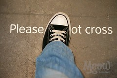 Please Do Not Cross (peterotoole) Tags: uk blue shadow people brown colour london sign horizontal museum modern concrete outdoors typography photography foot shoe stand shoes europe paint day forsale floor dynamic angle tate guidance grunge text  cement ground crack communication plastic jeans peter step fabric converse type getty rebellion stitching fade bluejeans dslr range breakingrules purchase laces oneperson rf gettyimages vag donotcross londonengland rebellious royaltyfree otoole tobuy capitalcities showlaces focusonbackground humanfoot lowsection canvasshoe westernscript d7k d7000 humanbodypart peterotoole