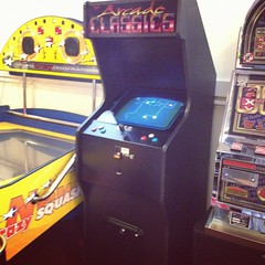 Old school arcade machine. (osh) Tags: wood bridge blue sunset sea summer england 6 sun shells fish beach rain weather birds sign yellow seashells port docks boats photography boat seaside fishing sand focus ship brother path stones wells hut pirate captain caution beachhut vans 4s siri pirateship bout hollister iphone wellsnextthesea summery ferryport vansoffthewall hollisterco waterbouy instagram iphone4s chiefscabin