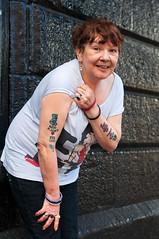 Tattooed ... in better days (Charles Hamilton Photography) Tags: people tattoo 50mm glasgow candid streetportrait saltmarket tattooed glasgowrangers nikond90 glasgowcharacter glasgowstreetportrait