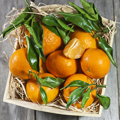 Fresh tangerines in wooden box (Speleolog) Tags: food orange white color macro green nature fruits closeup tangerine dessert leaf juicy healthy raw drink eating vibrant group large lifestyle objects stack full part health vegetarian tropical backgrounds mandarin citrus organic agriculture heap healthcare freshness ripe refreshment vitamin antioxidant