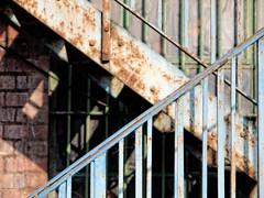Crossed (Mac McCreery) Tags: metal rust staircase sigma1770dcmacro pentaxk5iis