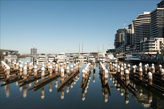 melbourne-2887-ps-w (pw-pix) Tags: bridge blue sky water docks buildings reflections boats wooden apartments harbour crane towers caps restaurants sunny australia melbourne victoria cranes clear wharf shops docklands yachts pylons piles victoriaharbour boltebridge formerdockarea formerwharfsheds