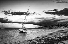 Blown Away (noldski2) Tags: sea bw water monochrome clouds lens boat waterfront olympus victoria kit geelong 1442