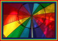 celebrate diversity (milomingo) Tags: multicolored umbrella geometry symmetry bright bold vivid frame border photoborder geometric light shadow color round circle spoke soe colorsinourworld triangle angle diagonal perspective