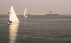 Riflessi.. (paolotrapella) Tags: beach water canon mare acqua spiaggia riflesso barcaavela tamron70300vc