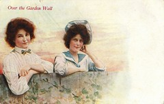 Antique Postcard - Two Women Chatting (Brynn Thorssen) Tags: sunset roses two sky woman hat smiling wall clouds vintage fence healthy women dress post cloudy antique postcard smiles tie card bow sailor chatting caucasian blushing whiteshirt brownhair chubbycheeks wildroses frizzyhair frizzy caucasion sailordress