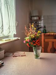 grandma's. (Karo Krmer) Tags: tisch table bunch flowers blumen brille glasses kche kitchen analog 35mm rollei35t ektar100 stilllife stilleben