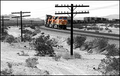 Code Line and an Eastbound (greenthumb_38) Tags: california railroad blackandwhite bw train blackwhite route66 mojave duotone locomotive bnsf mojavedesert thecut motherroad sanbernardinocounty railroading desertlife nationaltrails rte66 themotherroad nationaltrailshighway ashhill needlessub jeffreybass natltrailshwy ludlowadventure2012 thecutatashhill