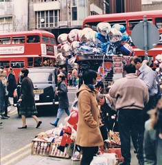 1984-12-18 London-11 (paul_appleyard) Tags: christmas street red black bus london balloons cab taxi balloon double aldwych oxford 1984 routemaster 13 seller decker