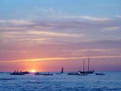 sunset at Tamarindo beach (jaletta) Tags: ocean sunset sea sky seascape beach nature clouds boats costarica pacific tamarindo touchdown cloudporn