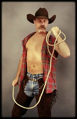 Roped (Cowboy Tommy) Tags: bear hairy hot sexy pecs leather fur model muscle blueeyes chest handsome rope moustache western loveline stache plaid levis cowboyhat nips chaps pinup rugged barechest bulge lasso centerfold