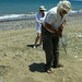 Andreas Demetropoulos probes the sand for turtle nests.