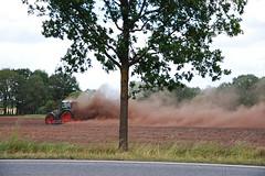 Trecker bei der Arbeit (antje whv) Tags: traktor landwirtschaft baum mecklenburg trecker staub feldarbeit staubwolke eggen