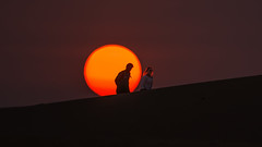BURNING HAIR (CUMBUGO) Tags: light sunset red people sun sunlight man color girl hair nikon asia sundown dune atmosphere ne vietnam 300mm nikkor f28 d800 mui d800e