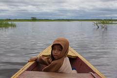 Down on the River, Iquitos. (Geraint Rowland Photography) Tags: portrait peru southamerica water clouds canon river reeds boat ship child vessel canoe hoody captain sail iquitos peruvian amazonian candidphotography amazonriver childportrait peruvianchild peruvianjungle travelinperu geraintrowlandphotography visitiquitos iquitosphotographybygeraintrowland