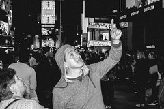Man Pointing Up In Times Square (l.a.nolan) Tags: nyc newyorkcity people woman ny newyork man night 35mm fuji manhattan f14 voigtlander streetphotography timessquare fujifilm newyorknewyork nokton 35mmf14 theempirestate nokton35mm xpro2 voigtlandernokton voigtlandernokton35mmf14 nokton35mmf14 fujifilmxpro2