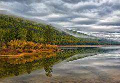 Autumn Serenity (Philip Kuntz) Tags: autumn fall reflections island montana stormy fallfoliage salmonlake