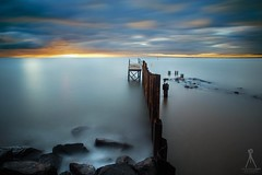 NEW BEGINNINGS (Vaughan Laws Photography   www.lawsphotography.com) Tags: ocean longexposure sunset sea seascape color beautiful clouds canon landscape outdoors rocks colorful outdoor dam fineart le pilings remains ndfilter leadingline neutraldensityfilter leadingout longshutterexposure longexposuresunset canon6d longexposurecolour nd10stop lawsphotography vaughanlaws